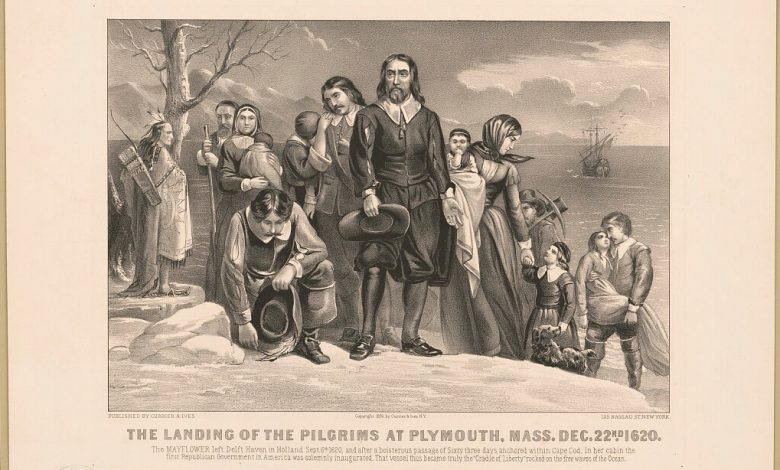 Pilgrims arrive at Plymouth Rock